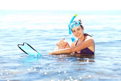 Girl with snorkel equipment Royalty Free Stock Images