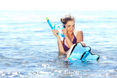 Girl with snorkel gear Stock Images