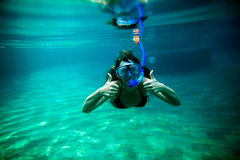 Girl snorkel underwater Stock Photo