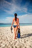 Girl and snorkeling gear Stock Photography
