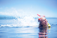 Girl after snorkeling. Haapy girl on a beach after snorkeling Stock Photo