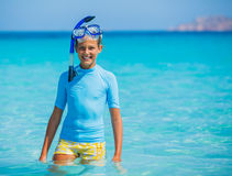 Girl snorkeling. Happy cute girl wearing snorkeling mask ready to dive in the sea Royalty Free Stock Images