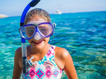 Girl snorkeling. Happy cute girl wearing snorkeling mask ready to dive in the sea Royalty Free Stock Photography
