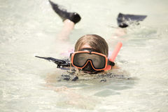 Girl snorkeling in ocean royalty free stock photography