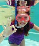 Girl snorkeling underwater Royalty Free Stock Image