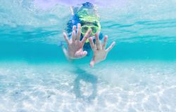 Girl in snorkelling mask dive. Royalty Free Stock Images