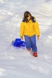 Girl in the snow Stock Photos