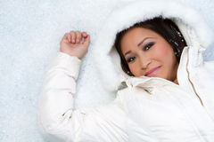 Girl in Snow. Pretty asian girl in snow Stock Photo