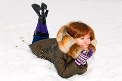 Girl on snow stock photo