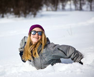 Girl in the snow. Girl laughing in the snow Stock Image
