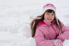 Girl On Snow Stock Photos