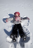 A girl on snow Stock Photography