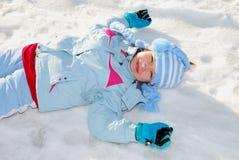 Girl in snow Stock Image