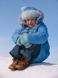 Girl on the snow Royalty Free Stock Image