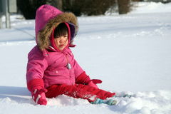 Girl in Snow. Girl playing in the snow royalty free stock photos