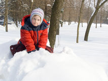 The girl and a snow Royalty Free Stock Photography
