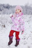 Girl with snow ball. Happy young winter girl with a snow ball Royalty Free Stock Image