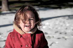 Girl and snow Stock Photos