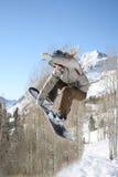 Girl snow boarder hits jump. Women snowboarder hits a jump and takes flight at snowbird ski and summer resort #4 Stock Photos