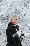 Girl among the snow-covered tree. Girl in winter forest near the snow-covered trees Royalty Free Stock Photo