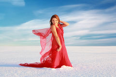 Girl at snow desert Royalty Free Stock Image