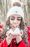 Girl and snow flakes Royalty Free Stock Images