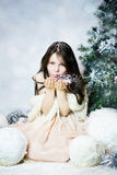 Girl in snow forest Royalty Free Stock Photo
