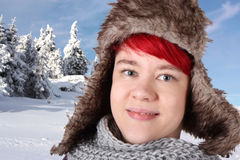 Girl in snow with fur cap Royalty Free Stock Photography
