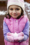Girl with snow in hands Stock Photos
