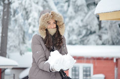 Girl with snow in the hands Stock Image