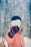 Girl with snow heart Stock Image
