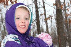 Girl with snow in her hands Stock Image