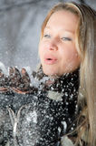 Girl with snow in her hands Royalty Free Stock Images