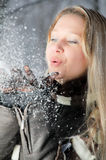 Girl with snow in her hands Stock Photography