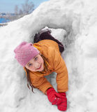 The girl in a snow hole Royalty Free Stock Photo