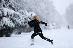 Girl in the snow Stock Image