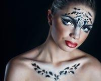 Girl snow leopard Stock Photos