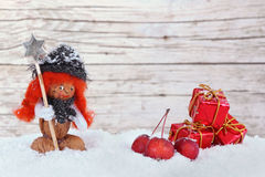 Girl in the snow, little apples and parcels Stock Photo