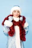 Girl in Snow Maiden costume with red tinsel Royalty Free Stock Image