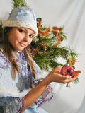 Girl Snow Maiden is decorated Christmas tree Stock Image