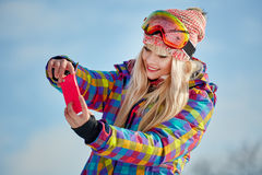 Girl  on the snow and is making a photo Royalty Free Stock Images
