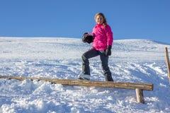 Girl on the snow Stock Photo