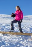 Girl on the snow Stock Photos