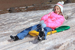Girl snow sliding Stock Photography