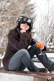 Girl in snow with virtual reality glasses Stock Photo