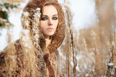 Girl in snow winter forest Stock Images