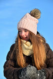 Girl in snow winter Stock Images