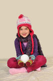 Girl with snowball Stock Photo