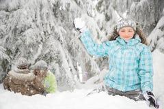 Girl with snowball Stock Photos