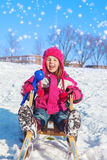 Girl with a snowball maker Royalty Free Stock Photo